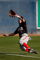 Tyler Yagi #1 of the Utah Utes dives to catch a flyball during a game against the Loyola Marymount Lions at Page Stadium on February 15, 2013 in Los Angeles, California. Utah defeated Loyola 6-3. (Larry Goren/Four Seam Images)