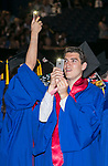 Graduates use their phone's lights to search for their family and friends in the crowd Sunday, June 11, 2017, during the DePaul University Driehaus College of Business commencement ceremony at the Allstate Arena in Rosemont, IL. (DePaul University/Jamie Moncrief)