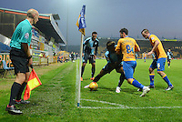 Wycombe Wanderers Gozie Ugwu keeps the ball in the corner under pressure from Mansfield Town's Chris Clements during the Sky Bet League 2 match between Mansfield Town and Wycombe Wanderers at the One Call Stadium, Mansfield, England on 31 October 2015. Photo by Garry Griffiths.