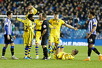 Nathan Dyer, Mike van der Hoorn, Matt Grimes and Jake Bidwell of Swansea City prpotest to referee David Webb for a foul against Bersant Celina of Swansea City who is laying on the ground during the Sky Bet Championship match between Sheffield Wednesday and Swansea City at Hillsborough Stadium, Sheffield, England, UK. Saturday 09 November 2019