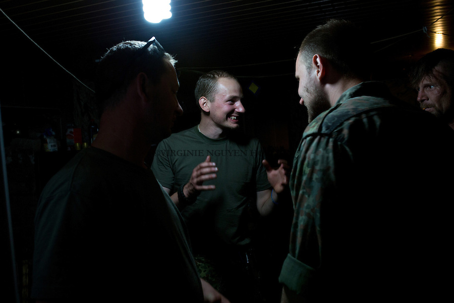 UKRAINE, Pisky: Dan - his nickname in the Unit - is chatting with his comrade from the Unit at night.<br />