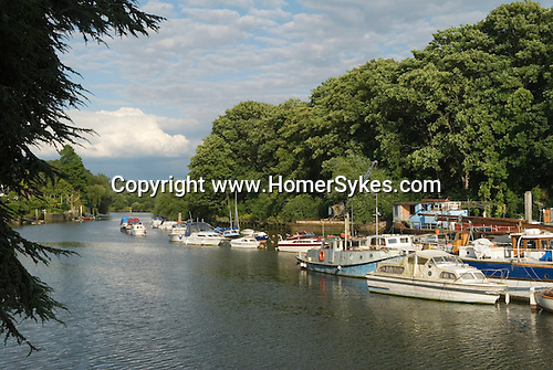 River Thames at Twickenham Middlesex.  Eel Pie island boat yard. View looking down river towards Richmond and London.