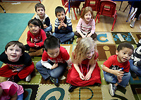 NWA Democrat-Gazette/DAVID GOTTSCHALK Students, including Javier Widger (from right) and Siara (cq) Sheridan, in Tammy Davis' and Julie Chambers' pre-k education class recite Wednesday, February 14, 2018, the days of the month at the Springdale Early Childhood Center. Early education options are steadily increasing as Northwest Arkansas' population grows and people want more choices.
