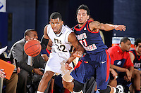 25 February 2012:  FIU guard Jeremy Allen (32) faces tough defense from South Alabama guard Freddie Goldstein (11) in the first half as the FIU Golden Panthers defeated the University of South Alabama Jaguars, 81-74, at the U.S. Century Bank Arena in Miami, Florida.
