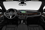Stock photo of straight dashboard view of a 2019 BMW X6 35i 5 Door SUV