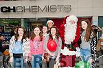 LIST: Given Santa their list at CH Chemist,Tralee on Saturday l-r Maeve Byrne,Ailish O'Sullivan,Alison O'Leary,Brenwyn Foley and Casey O'Mahony.