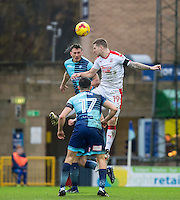 Will De Havilland of Wycombe Wanderers goes up against James Collins of Crawley Town during the Sky Bet League 2 match between Wycombe Wanderers and Crawley Town at Adams Park, High Wycombe, England on 25 February 2017. Photo by Andy Rowland / PRiME Media Images.