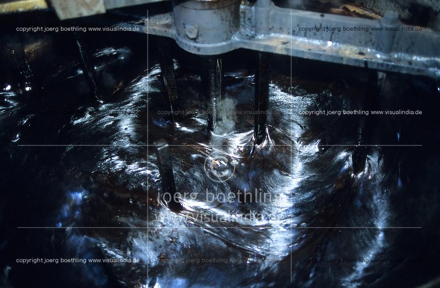 ITALY Calabria Rossano, old liquorice factory Amarelli, pure liquorice production from root of plant Glycyrrhiza glabra, liquorice juice from boiled roots / ITALIEN Kalabrien Rossano, alte Lakritz Fabrik Amarelli von 1731, Herstellung von purem Lakritz aus der Suessholzwurzel lat. Glycyrrhiza glabra, Sirup aus gekochten Suessholzwurzeln