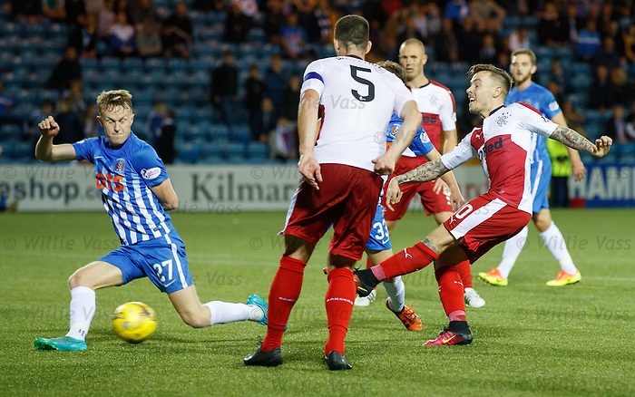Barrie McKay drills the ball through the legs