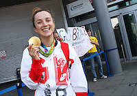 TEAM GB ATHLETES RETURN TO MANCHESTER AIRPORT<br /> TUESDAY 23RD AUGUST 2016<br /> <br /> ELINOR BAKER SHOWS OFF HER MEDAL WITH BRYONY PAGE<br /> <br /> Mandatory Credit - Alex Roebuck / www.alexroebuck.co.uk