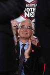 Campaign chairman Alastair Darling MP applauding a speech at an anti-Scottish independence Better Together rally at Community Central Hall, Glasgow. The event was staged by Better Together who were campaigning to prevent an independent Scotland from leaving the United Kingdom. On the 18th of September 2014, the people of Scotland voted in a referendum to decide whether the country's union with England should continue or Scotland should become an independent nation once again.