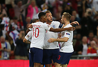England's Marcus Rashford celebrates with Harry Kane and Luke Shaw after scoring his side's first goal<br /> <br /> Photographer Rob Newell/CameraSport<br /> <br /> UEFA Nations League - League A - Group 4 - England v Spain - Saturday September 8th 2018 - Wembley Stadium - London<br /> <br /> World Copyright &copy; 2018 CameraSport. All rights reserved. 43 Linden Ave. Countesthorpe. Leicester. England. LE8 5PG - Tel: +44 (0) 116 277 4147 - admin@camerasport.com - www.camerasport.com
