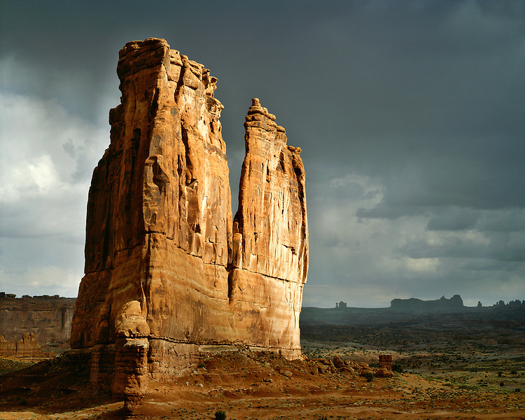 Storm light on Courthouse Towers; Arches National Park, UT