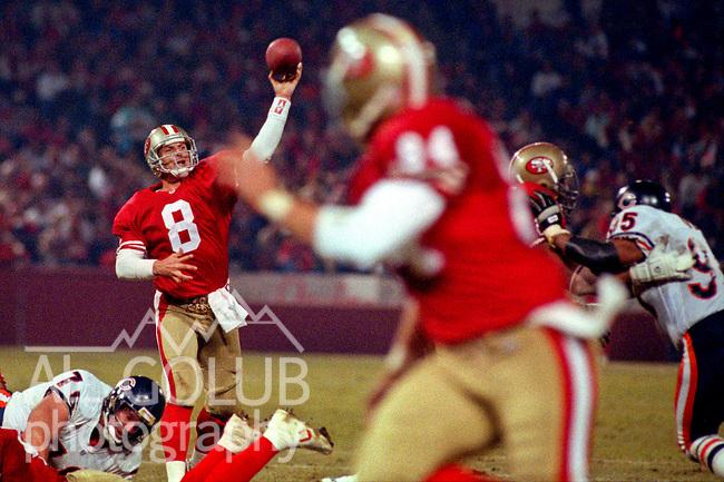 San Francisco 49ers vs. Chicago Bears at Candlestick Park Monday, December 23, 1991.  49ers beat Bears 52-14.  49er quarterback Steve Young (8) passes to tight end Brent Jones (84).