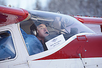 February 16, 2013  Volunteer Iditarod Air Force pilot Erin Marston taxis with a load bound for Finger Lake at the Willow airport as musher food, straw, HEET and people food is flown to the 4 checkpoints on the east side the Alaska Range. ..Iditarod 2013 Photo Copyright Jeff Schultz  -- Do not reproduce without written permission