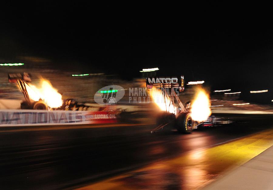 Oct. 14, 2011; Chandler, AZ, USA; NHRA top fuel dragster driver Antron Brown (right) races alongside Tony Schumacher during qualifying at the Arizona Nationals at Firebird International Raceway. Mandatory Credit: Mark J. Rebilas-