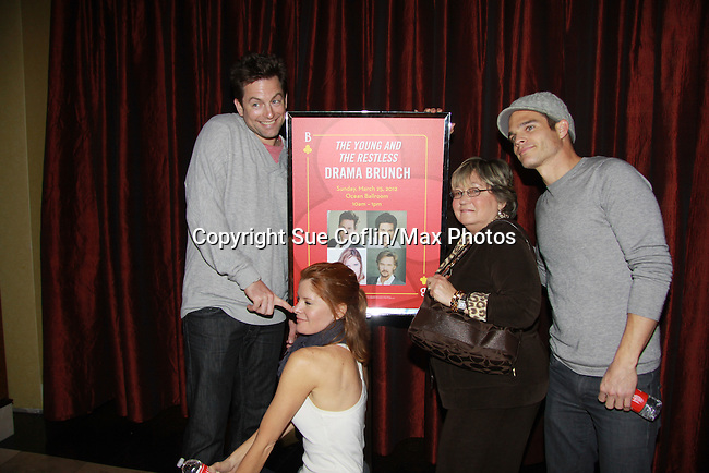 "Drama Brunch - The Young & The Restless stars Greg Rikaart & Michael Muhney and Michelle Stafford pose with Joyce Becker with Soap Opera Festival sign came for the fans with a brunch and photos during the Soap Opera Festivals Weekend - ""All About The Drama"" on March 25, 2012 at Bally's Atlantic City, Atlantic City, New Jersey.  (Photo by Sue Coflin/Max Photos)"