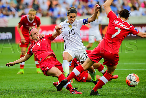 21 FEB 2016: United States Midfielder Carli Lloyd (10) tackles Canada Defender Josée Belanger (9) during the Women's Olympic qualifying soccer final between Canada and USA at BBVA Compass Stadium in Houston, Texas. (Photo by Ken Murray/Icon Sportswire)