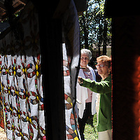 NWA Democrat-Gazette/ANDY SHUPE<br /> Diane Pennington (left) of Lowell speaks with Lois Arnold of Springdale Saturday, Sept. 12, 2015, while describing a Wedding Ring-pattern quilt that her 102-year-old grandmother, Vola Watson-Edgmon of Lowell, began and Pennington finished by hand during the 38th annual Ozark Quilt Fair at the Shiloh Museum of Ozark History in Springdale. The fair included historic and newly made quilts as well as opportunities to visit with area quilters.