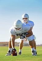 Sept. 16, 2009; Casa Grande, AZ, USA; California Redwoods center (67) Matt Lentz prepares to snap the ball to quarterback (18) Liam O'Hagan during training camp at the Casa Grande Training Facility & Performance Institute. Mandatory Credit: Mark J. Rebilas-