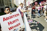 Anti-abortion activists greet the thousands of pro-choice activists who marched across the Brooklyn Bridge and on to City Hall on August 28, 2004 in New York City for the Planned Parenthood March for abortion rights during the Republican National Convention.