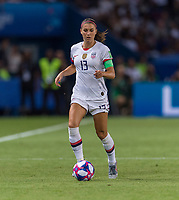 PARIS,  - JUNE 28: Alex Morgan #13 dribbles during a game between France and USWNT at Parc des Princes on June 28, 2019 in Paris, France.