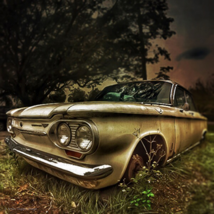Rusting car abandoned in the countryside