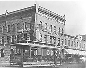 Smelter National Bank - Newman Block - Main Ave.  #5 trolley car in front of bank. - &quot;Durango, Brookside and Animas City.&quot;  Patriotic flag and bunting on bank.<br /> Durango, CO