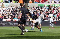 Pictured L-R: Match referee Mike Jones watches on as David Silva of Manchester City challenges Leon Britton of Swansea which goes wide, while he is chased by Samir Nasri and Matija Nastasic of Manchetser City. Saturday 04 May 2013<br /> Re: Barclay's Premier League, Swansea City FC v Manchester City at the Liberty Stadium, south Wales.