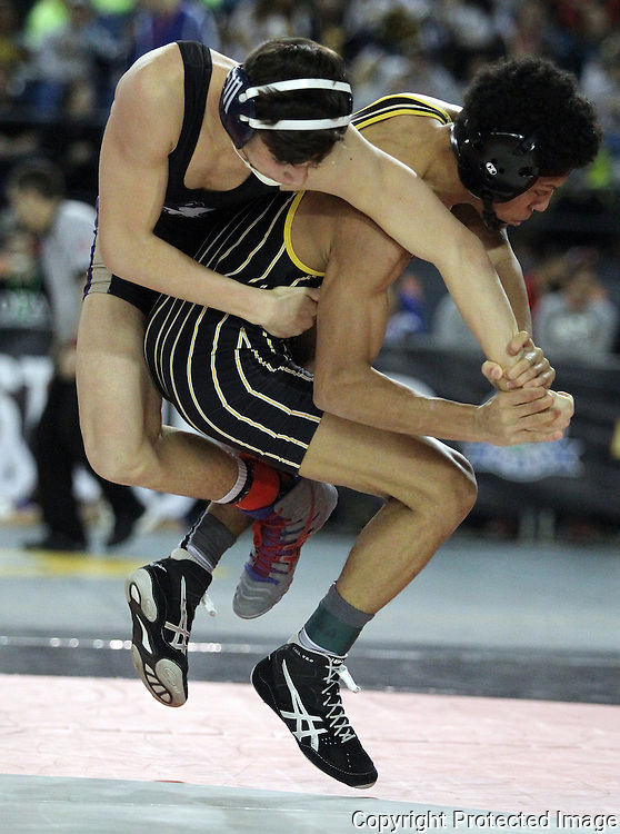 Hudson Bay's  132 pounder Darion Green, right,  escapes from  Sequim's Graig Baker to earn one point on Friday, Feb, 19, 2016 at the Mat Classic XXVIII held in the Tacoma Dome. Green went onto win his match 13-6.  (Jim Bryant Photo)