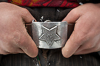 Detail of Daryo Boi's belt, with a Russian star..In and around the campment of Kyzyl Qorum, campment of the former deceased Khan, Abdul Rashid Khan...Trekking with yak caravan through the Little Pamir where the Afghan Kyrgyz community live all year, on the borders of China, Tajikistan and Pakistan.