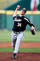 Connor Podkul (34) of the Purdue Boilermakers delivers a pitch during a game against the Missouri State Bears at Hammons Field on March 13, 2012 in Springfield, Missouri. (David Welker / Four Seam Images).