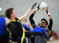 27 MAY 2013 - DONCASTER, GBR - Mandip Sehmi (right) of Kent Crusaders catches a pass during the 2013 Great Britain Wheelchair Rugby Nationals final against the Stoke Mandeville Storm at The Dome in Doncaster, South Yorkshire .(PHOTO (C) 2013 NIGEL FARROW)