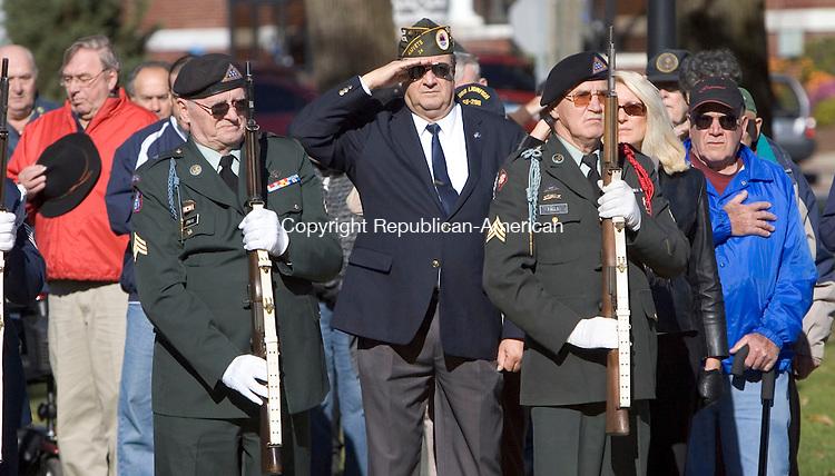 TORRINGTON, CT. 11 November 2010-111110SV06--Veterans give a salute to the flag during the Pledge of Allegiance at the Veterans Day ceremonies in Torrington Thursday.<br /> Steven Valenti Republican-American