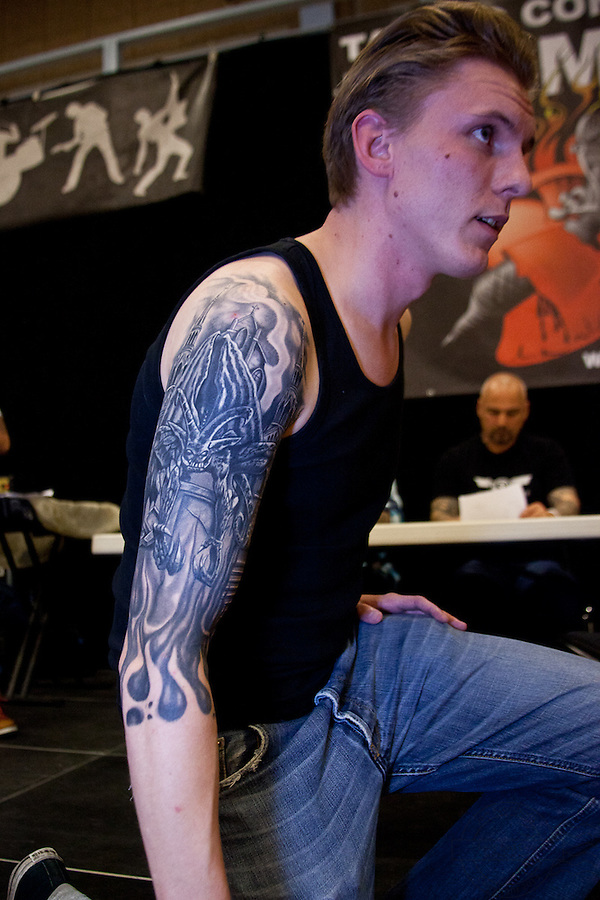 Tattoo Convention in Kolding 2011. Arranged by BodyMod.dk<br /> Young man with black and grey tattoo on right arm.