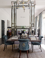 The double-length living area is divided by a central fireplace surround on which hangs an artwork by Simon Patterson