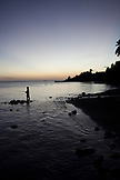 FRENCH POLYNESIA, Tahiti. A fisherman in the water along the southern coastline of Tahiti Island.