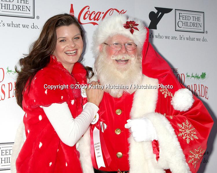 Heather Tom & Santa Claus Tom Connaghan.arriving at the 2009 Hollywood Christmas Parade .Hollywood Roosevelt Hotel.Los Angeles,  CA.November 29, 2009.©2009 Kathy Hutchins / Hutchins Photo.