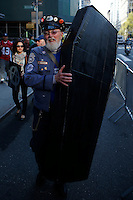 New York, USA. 1st May 2014.  A man carries a fake coffin while he attends the annual 1 May day rally in New York.  Eduardo MunozAlvarez/VIEWpress