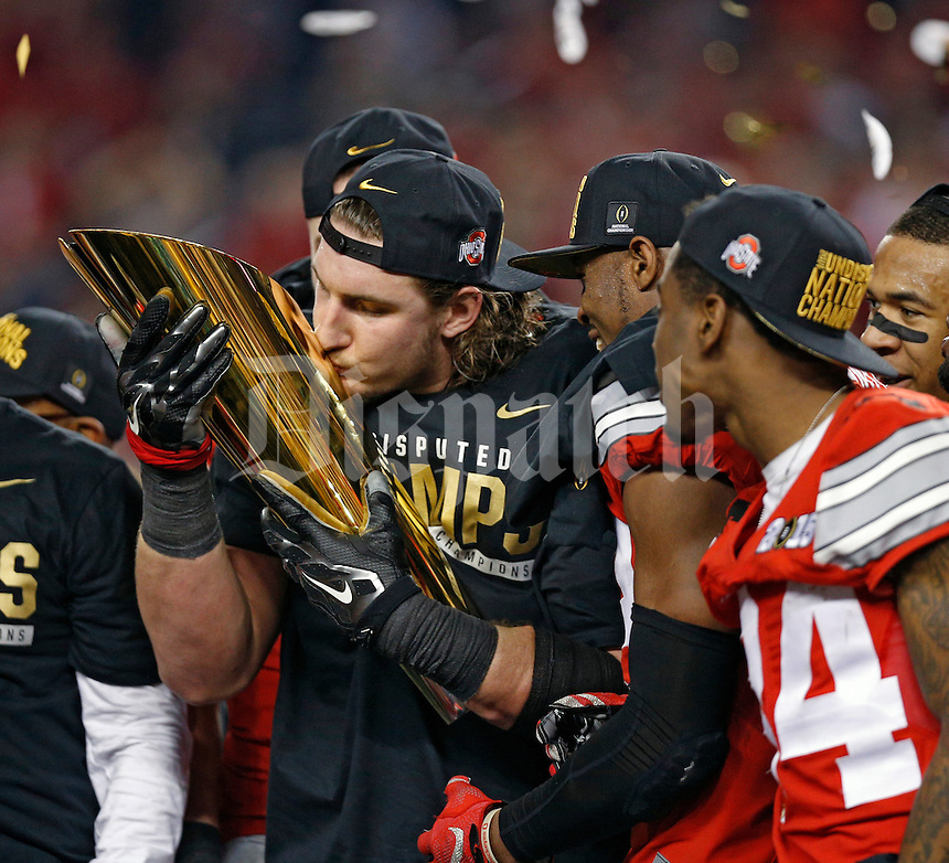 Ohio State Buckeyes defensive lineman Joey Bosa (97) celebrate beating Oregon Ducks 42-20 in College Football Playoff Championship game at AT&T Stadium in Arlington, Texas on January 12, 2015.  (Dispatch photo by Kyle Robertson)