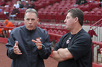 Head coach Jack Leggett (7) of the Clemson Tigers, left, talks with head coach Ray Tanner (1) of the South Carolina Gamecocks before a game on March 3, 2012, at Carolina Stadium in Columbia, South Carolina. Carolina won, 9-6. (Tom Priddy/Four Seam Images)