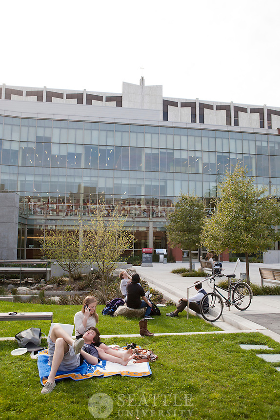 04092012-  Students relax on the grass outside the Library on a warm spring day.