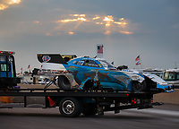 Jun 2, 2018; Joliet, IL, USA; The damaged car of NHRA funny car driver John Force is taken off the track by a flat bed tow truck after crashing into the wall during qualifying for the Route 66 Nationals at Route 66 Raceway. Mandatory Credit: Mark J. Rebilas-USA TODAY Sports