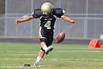 Palos Verdes, CA 09/22/11 - Kyle Katayama (Peninsula #4)) in action during the Beverly Hills-Peninsula Varsitty Football gane.