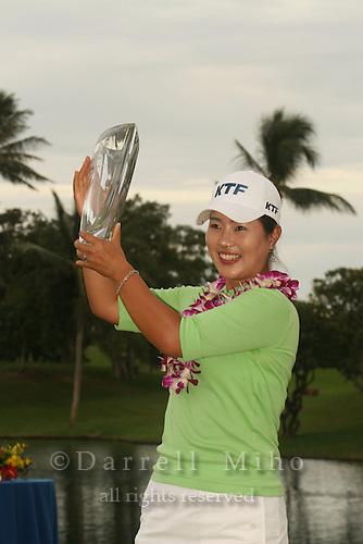 Feb 24, 2006; Kapolei, HI, USA; Meena Lee holds up her trophy after winning the inaugural LPGA Fields Open at Ko Olina Resort...Photo Credit: Darrell Miho.Copyright © 2006 Darrell Miho