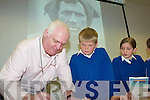 CREAN: Tom Crean author, Michael Smith signs his book for Kilflynn school pupils at Tralee library on Friday, l-r: Michael Smith, Dylan McElligott, Lilou Le Prince.   Copyright Kerry's Eye 2008