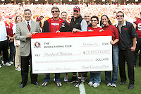 14 October 2006: Bob Bowlsby with the check presentation from the Buck Cardinal Club during Stanford's 20-7 loss to Arizona during Homecoming at Stanford Stadium in Stanford, CA. Pictured are Chuck Evans, Kevin Richardson, Sarah Gaeta, Laurie Sawin Quinn, and Doug Yarris.