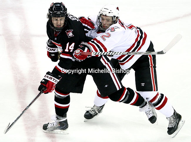 UNO's Brock Montpetit hits St. Cloud State's Nick Jensen during the second period. UNO beat St. Cloud State 3-0 Friday night at Qwest Center Omaha.  (Photo by Michelle Bishop)