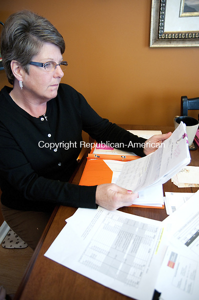 TORRINGTON, CT - 04 APRIL 2014 --Catherine Grenier, of Torrington, in the midst of a dispute between her bank and Tax Collector Robert T. Crovo. Alec Johnson/ Republican-American
