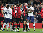 Tottenham's Moussa Sissoko is held back by Bournemouth's Steve Cook after clashing with Bournemouth's Jefferson Lerma during the Premier League match at the Tottenham Hotspur Stadium, London. Picture date: 30th November 2019. Picture credit should read: Paul Terry/Sportimage
